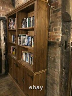Large solid pine bookcase with antique finish in excellent condition